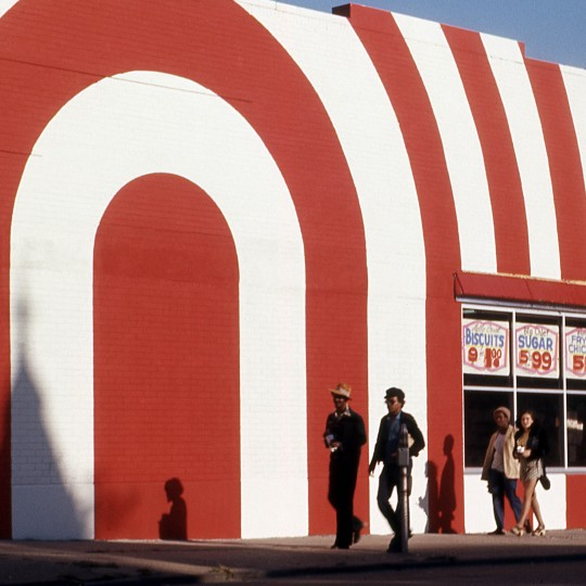 """""""Untitled (Red and White Striped Storefront with Passersby),"""" around 1970, attributed to Allen Stross, color transparency film. Detroit Institute of Arts"""