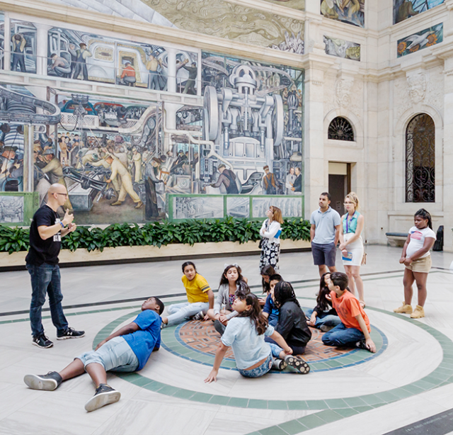 Students on a field trip in the DIA's Rivera Court